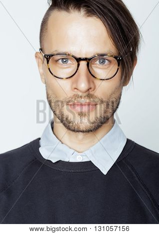 handsome middle age man with modern hairstyle and tattoo, beard, close up on white background, lifestyle people concept