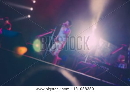 Blurred of singer in concert live music