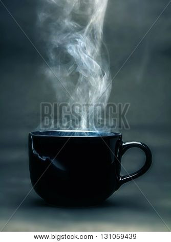 still life with the warm drink black cup vintage retro blue color tone