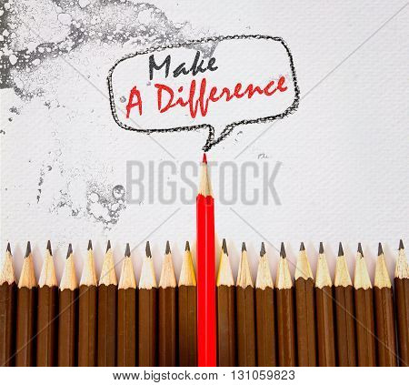 the red wooden pencil arrange on dirt watercolor paper with make a difference concept