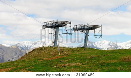 Mechanical ski lift in the mountains in spring