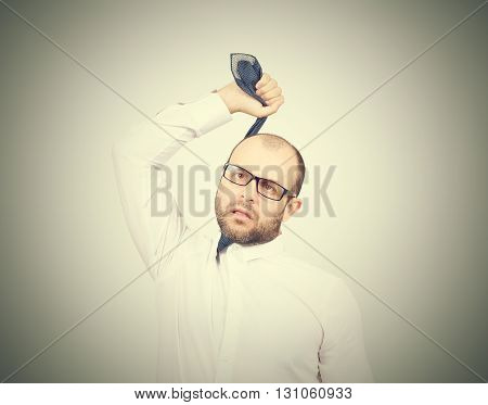 Suicidal Businessman Strangling Himself Tie