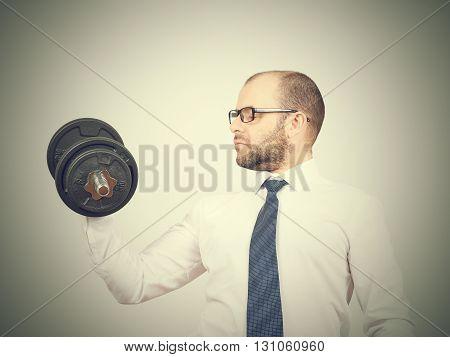 Man Trained Businessman Raises Dumbbell.