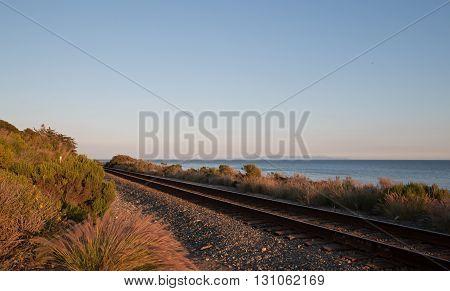 Railroad tracks on the Central Coast of California at Goleta at sunset USA