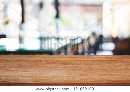 Top of wooden table with blurred cafe background, stock photo