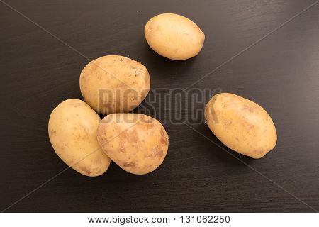 top view of fresh potatoes on a black background