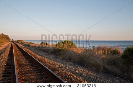 Railroad tracks on the Central Coast of California at Goleta / Santa Barbara at sunset USA