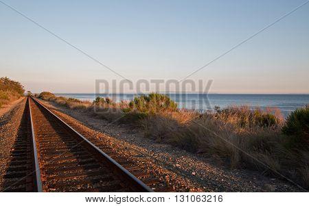 Railroad tracks on the Central Coast of California at Goleta / Santa Barbara at sunset USA