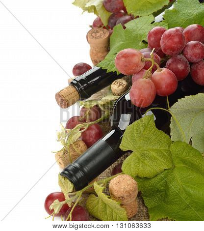Bottle of wine and grapes on a white background
