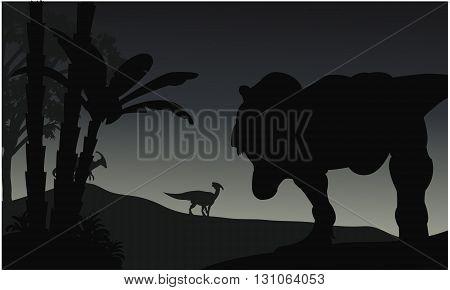 Silhouette of Tyranosaurus and Parasaurolophus at the night