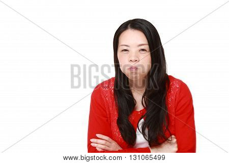 portrait of Japanese woman in a bad mood on white background