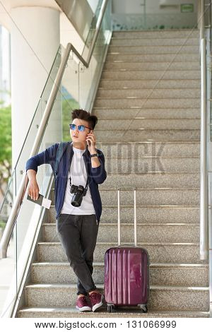 Young man waiting for his flight in airport