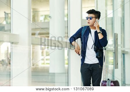 Tourist calling on phone when waiting for his flight