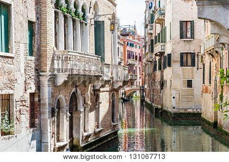 Scenic canal with bridge and ancient buildings in Venice Italy