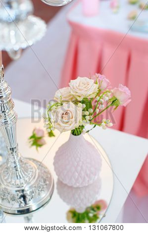 decor of flowers on wedding table in a restaurant.