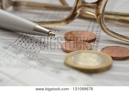Financial background with money glasses table and pen.