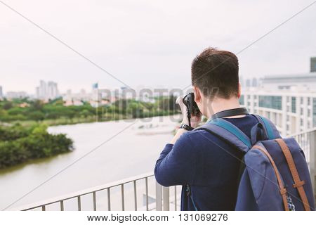 Professional photographer taking pictures of city view