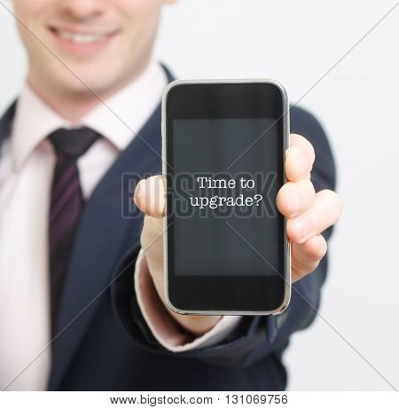 A business man showing his old phone