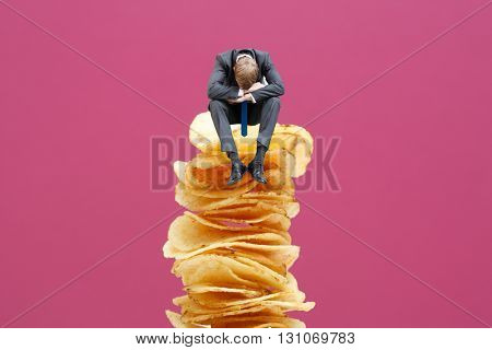 Unhealthy food and businessman