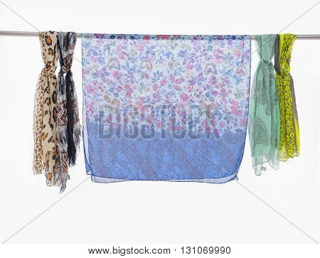 Silk colored scarves on a hanger