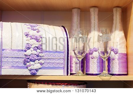 glasses of champagne and a box of money on a wedding in purple tones.
