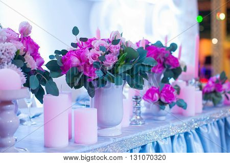 decor of flowers on a wedding table in a restaurant.