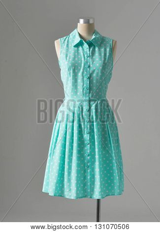 women blue dress on dummy â?? gray background
