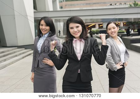 confident and successful business woman with her team