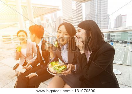 group of Asian business team having lunch in the outdoor