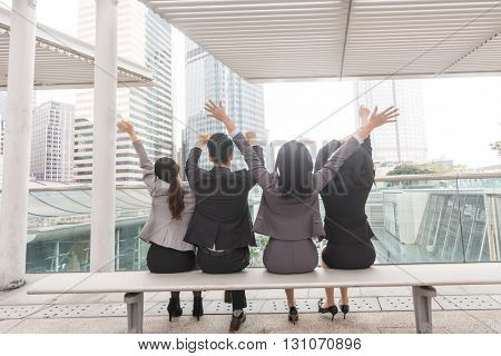 group of business man and woman sit in the outside of office in Hong Kong