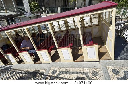 BRAGA, PORTUGAL - September 21, 2015: View of the funicular tram interior set up and the Portuguese style cobblestone access platform on September 21, 2015 in Braga, Portugal