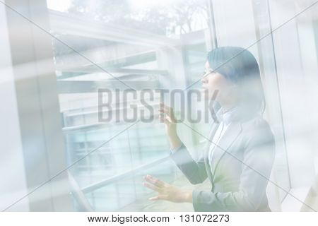 Asian business woman touch the screen or the glass