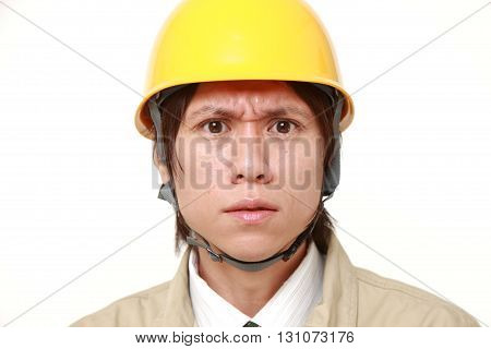 portrait of angry construction worker on white background