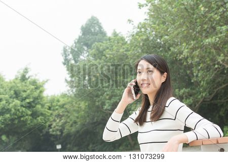 asian woman use cellphone