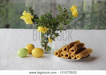 Easter eggs crisp waffles and a bouquet of yellow roses
