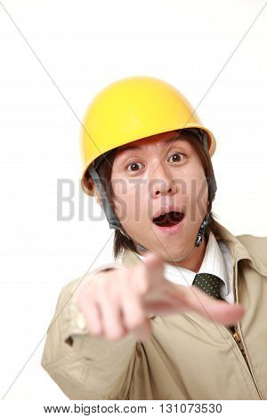 portrait of young Japanese construction worker witnessed something on white background
