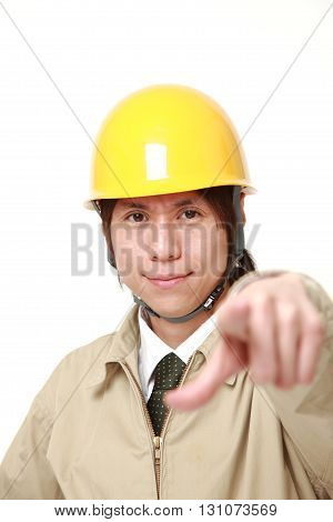 portrait of Japanese construction worker decided on white background