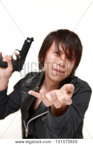 studio shot of robber with a handgun