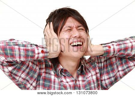 portrait of Young Japanese man suffers from noise on white background