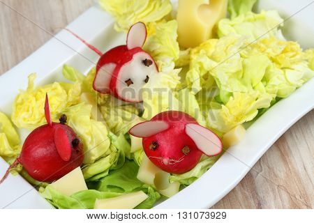 Mouse from radish. Mice made from radish. Radish for children. Raw radish. Children party.