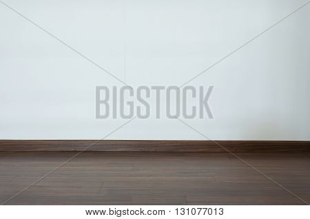 Empty Room, White Mortar Wall Background And Wood Laminate Floor