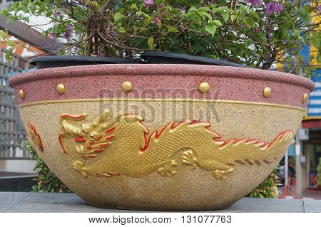 Beautiful of flowerpot dragon pattern was placed at roadside in Thailand.