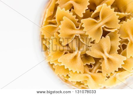 Detail of a plate of whole wheat pasta with soft edges and copyspace.