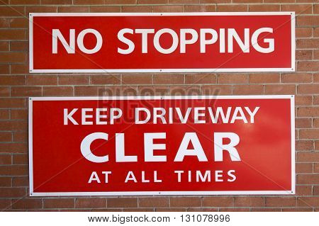 No Stopping: Keep Driveway Clear at all Times sign.