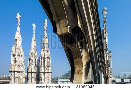 Italy Milan spires and marle works of the Duomo cathedral rooftop