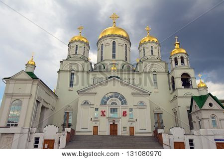 the Church of St. Nicholas the Wonderworker (the city of Nizhny Novgorod Avtozavodskiy district Russia) and cumulonimbus clouds
