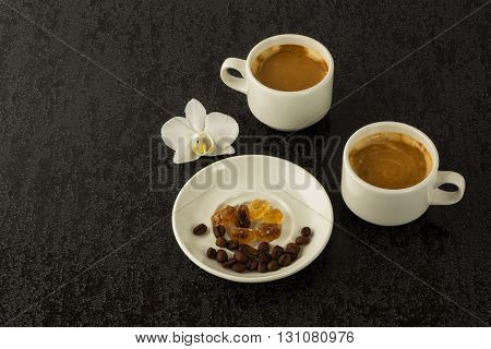 Coffee mugs and coffee beans on the black background. Morning coffee. Coffee cup. Coffee break. Cup of coffee.