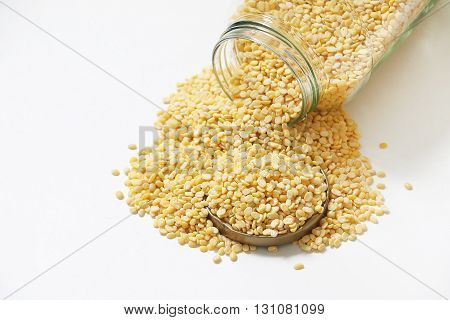 Raw dal or Lentil in jar on white isolated background