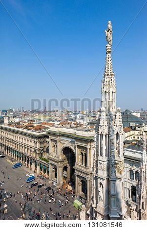 Milan Italy - April 21 2011: The Duomo square and Vittorio Emanuele gallery seen from the rooftop of the Duomo cathedral