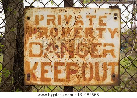 Private Property Danger Keep Out Sign Rusted Fence